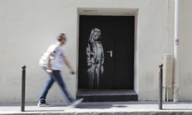 Recuperata in Abruzzo la porta del Bataclancon il murale diBansky